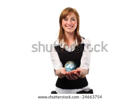 Studio lite shot of a business woman with a globe in her habd - stock photo