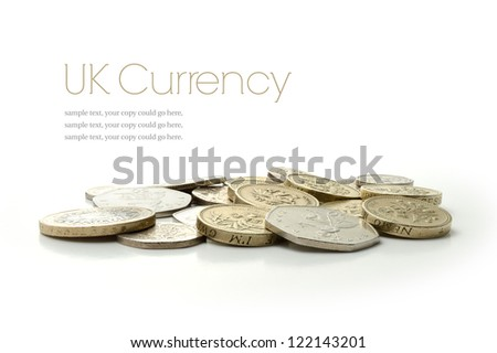Studio macro image of UK currency coins with soft shadows against a white background. Copy space. - stock photo