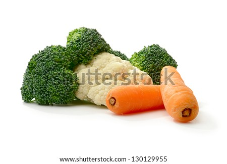 Studio macro of brocolli, cauliflower and carrots with soft shadows on a white surface. Copy space. - stock photo