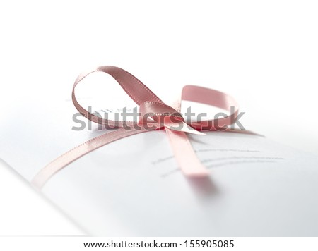 Studio macro of legal court papers tied with pink ribbon with soft shadows on a white surface. Copy space. - stock photo