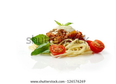 Studio macro of Spaghetti Bolognese meal with basil leaves, grated parmesan cheese and tomatoes. Copy space. - stock photo