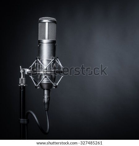 studio microphone on a black background - stock photo