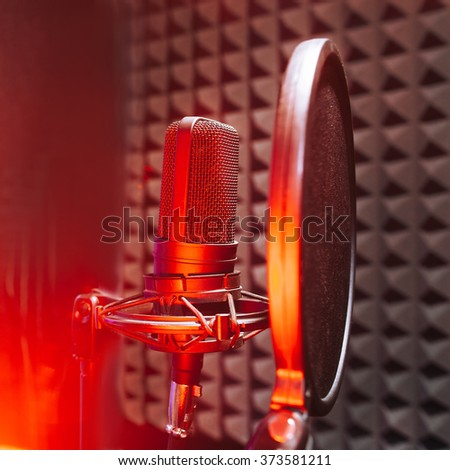 Studio microphone with red on air light - stock photo