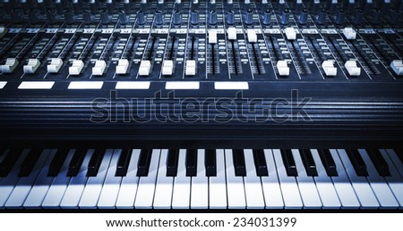 studio mixer & keyboard, electric piano, synthesizer in home studio - stock photo
