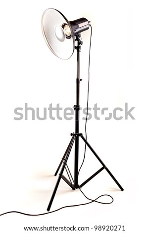 studio monoblock flash light on tripod isolated on white background