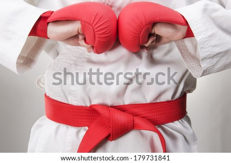 Studio of the karate girl with gloves and the red belt - stock photo