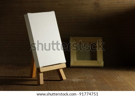 studio painter with easel and canvas, old wood - stock photo
