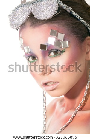 Studio photo - beauty portrait of a dark-haired girl with stylish make-up art and additional accessories, stylish glasses on light background