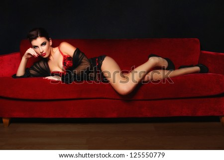 Studio Photo of a Sexy Woman on a Couch