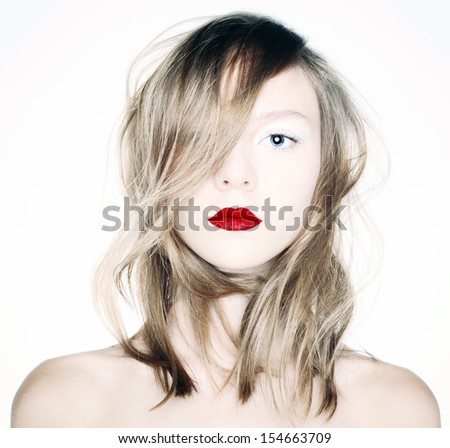 Studio photo of a young blonde with red lips. - stock photo
