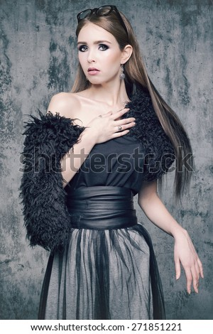 Studio photo of a young female actress in the image of the 1920s. - stock photo