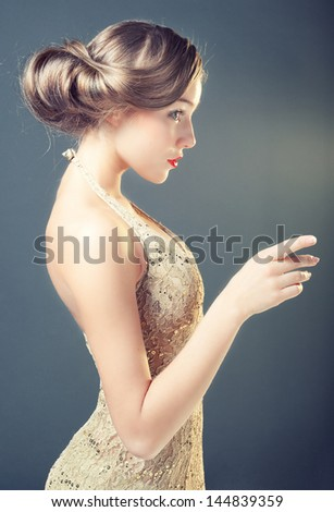 Studio photo of a young woman in retro style - stock photo