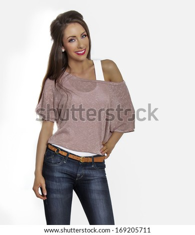 Studio photo of attractive young woman isolated against white background - stock photo