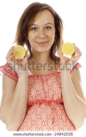 studio photo of beauty pregnant woman with lemon