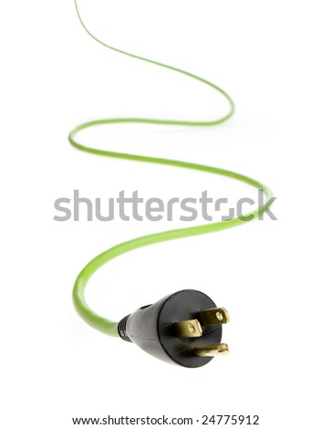 Studio photo of bright green electrical cable with plug in foreground. - stock photo