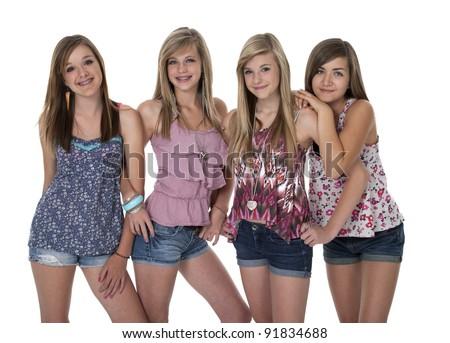 Studio photo of four pretty teenage girls in tight group on white. - stock photo