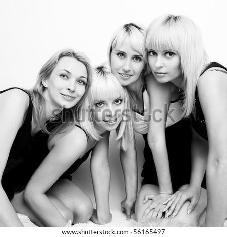 Studio photo of four young beautiful women - stock photo
