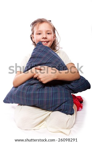 studio photo of little girl with pillow