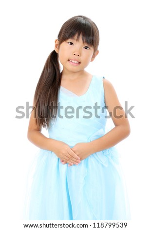 Studio photo of lovely little asian girl with hands crossed