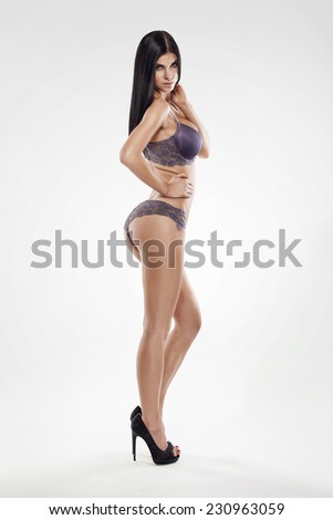 studio photo of posing sexy woman with nice lingerie on white background - stock photo