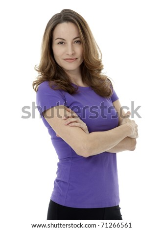 Studio photo of pretty brunette woman standing with arms crossed on white background. - stock photo