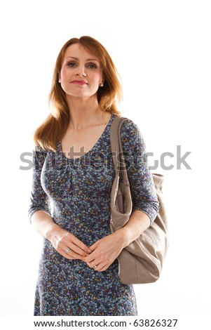 Studio photo of pretty woman walking in a shopping centre . - stock photo