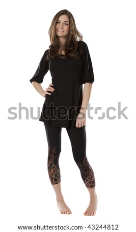 Studio photo of pretty young woman standing barefoot on white background. - stock photo