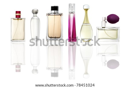 Studio photo of set of luxury perfume bottles. Isolated on white background - stock photo
