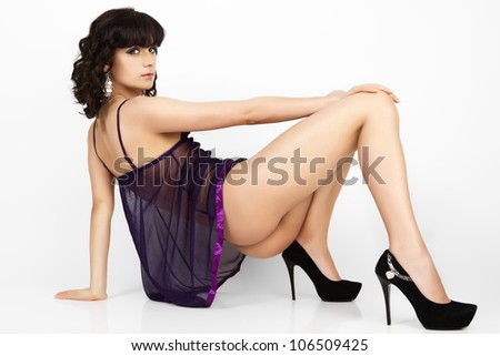 Studio photo of sexy woman in black lingerie against grey background - stock photo