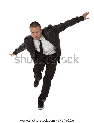 Studio photo of stylish young man in hip hop pose on white background.