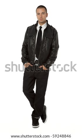 Studio photo of trendy young man standing on white background. - stock photo