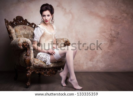 Studio photo of vintage sexy young woman in corset - stock photo