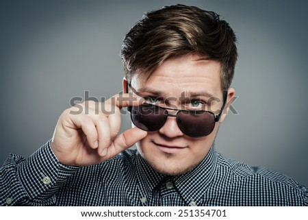 Studio photo of young attractive man in glasses - stock photo