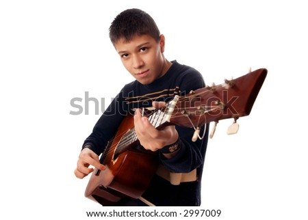 Studio photo of young boy playing guitare - stock photo