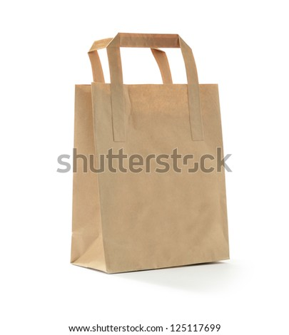 Studio photograph of a small brown bag against a white background with soft shadows. Copy space. - stock photo