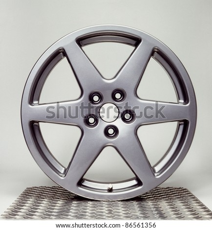 studio photography of a a wheel rim in light back - stock photo
