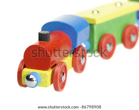 studio photography of a colorful wooden toy train in white back