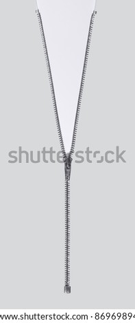 studio photography of a long zipper half closed, in light back - stock photo