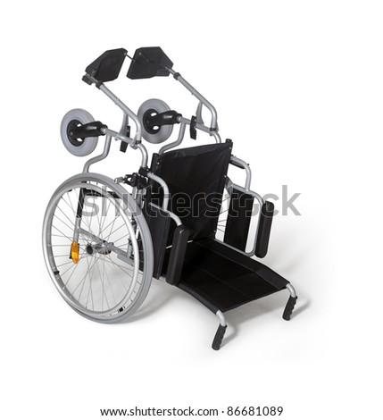 studio photography  of a turn over wheelchair in white back with shadow - stock photo