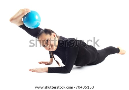 Studio photography of young professional gymnastic posing a split stretching with boll on white