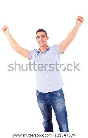 Studio picture of a happy young man with arms raised - stock photo