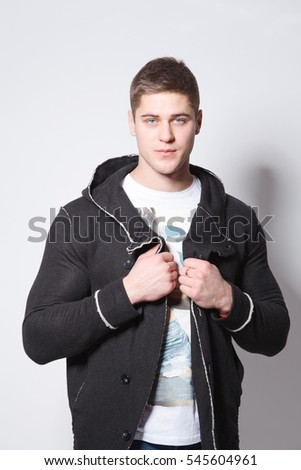 Studio picture of a young and handsome man