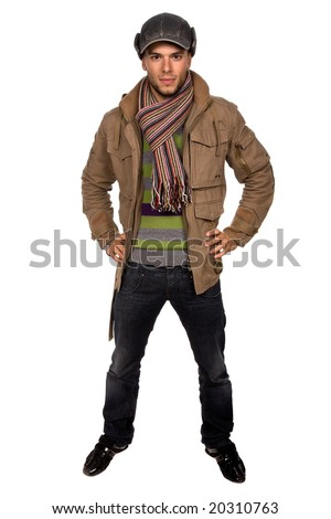 studio picture of a young man dressed for winter - stock photo