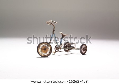 Studio picture of an old children tricycle - stock photo
