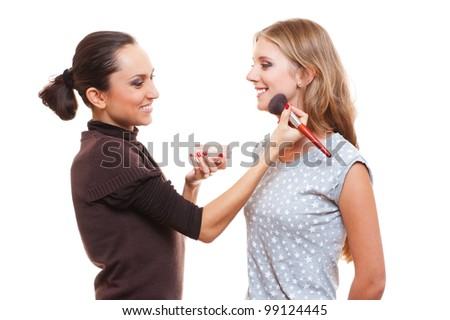 studio picture of make up artist and young woman. isolated on white - stock photo