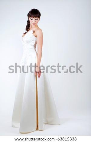 Studio portrait girl beautiful bride in white dress - stock photo