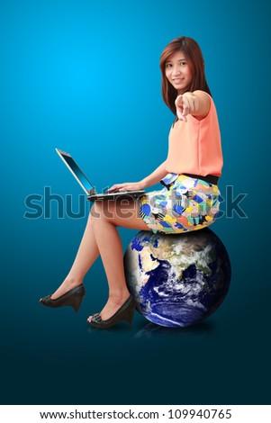 Studio portrait lady on globe isolated : Elements of this image furnished by NASA - stock photo