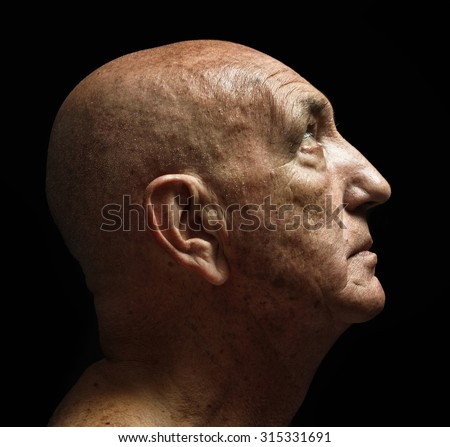 studio portrait of a bald old man - stock photo