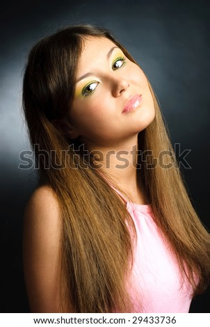studio portrait of a beautiful brunette model with colorful makeup - stock photo