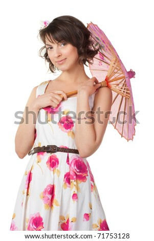 Studio portrait of a beautiful girl in a summer dress with a pink umbrella - stock photo